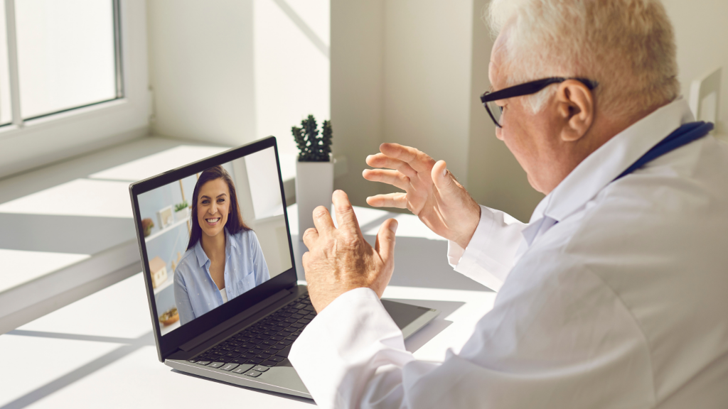 Doctor holding Zoom for healthcare session