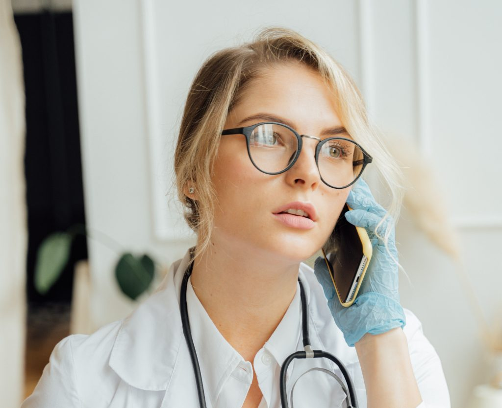 doctor holding phone consultation